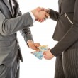 Man gives woman money while shaking hands — Stock Photo #47754293