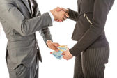 Man gives woman money while shaking hands — Stock Photo