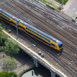 Aerial view of Dutch train at a bridge crossing a canal — Stock Photo #48720261