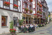 BERNKASTEL, GERMANY - JUL 21: Historic center of medieval city Bernkastel with unknown tourists sitting at several terraces  on July 21, 2012 at Bernkastel, Germany — Stock Photo