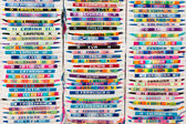 Colorful arm bracelets with embroidered names — Stockfoto