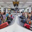 Airplane travelers waiting for their luggage at Schiphol airport in Amsterdam, The Netherlands — Stock Photo #51557195