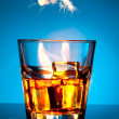 Stock Photo: Glass of scotch whiskey and ice