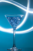 Colourful coctail on the blue background — Stock Photo