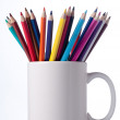Various colour pencils in cup. — Stockfoto