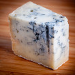 Blue cheese on wooden background — Stock Photo