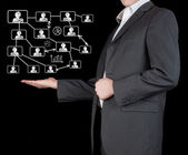 Graphs on the hands of businessmen. — Stock Photo