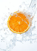 Orange in water splash — Stock Photo