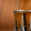 Two glass beer on wood background with copyspace — Stock Photo #26082643