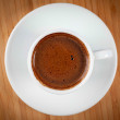 White ceramic coffee mug on the saucer. Top view.  on wooden. — Stock Photo
