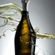 Bottle of champagne with splashes — Stock Photo