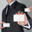 Close-up of business card in businessman hand — Stock Photo