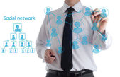 Businessman drawing a social business network scheme on a whiteboard — Stock Photo