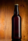 Fresh beer over wooden surface — Stock Photo