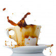 Coffee splashing out of a cup — Stock Photo