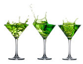 Green alcohol cocktail set with splash — Stock Photo