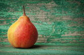 Sweet pear closeup on wooden background — Stock Photo