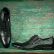 Fashion concept with male shoes on wooden — Stock Photo #31267751