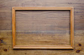 Old wooden frame on wood background — Stock Photo