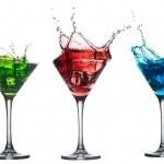 Red cocktail splashing into glass on white — Stock Photo #33393309