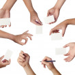 Set of hands holding empty business cards on white — Stock Photo #36804211