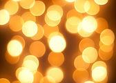 Bright glowing yellow lights background — Stock Photo