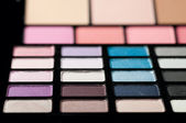 Make-up colorful eyeshadow palettes close up — Stock Photo