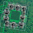 Stock Photo: Microchip integrated on motherboard