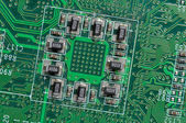 Microchip integrated on motherboard — Stock Photo