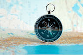 Compass on the map on the area of confusion — Stock Photo