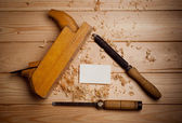 Carpentry tools on wooden background — Stock Photo