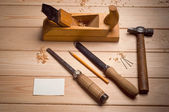 Desk of a carpenter with some tools — Stock Photo