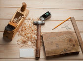 Some carpenter tools on wooden box — Stock Photo
