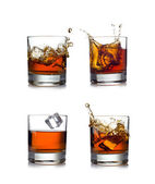 Whisky splash isolated on a white background — ストック写真