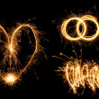 Valentine's Day simbols made of fire. — Stock Photo