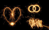 Valentine's Day simbols made of fire. — Stock Photo
