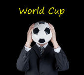 Man in suit holding a soccer ball in front of his face. Football  world cup — Foto de Stock