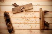 Joiner tools on wood table background with Woodchips — Stock Photo