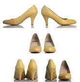 Yellow high heel women shoes — Stock Photo