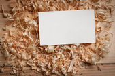 Empty Business cards on wooden chips close up — Stock Photo