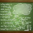 Close up of math formulas on a blackboard - Stock Photo