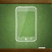 Sketch tablet pc on school blackboard — Stock Photo