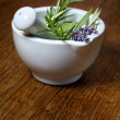 Mortar with the herbs rosemary and lavender — Stock Photo