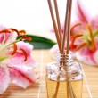 Fragrance sticks or Scent diffuser with lily flowers — 图库照片