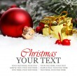 Christmas border with ornament, golden present and snow. - Stock Photo