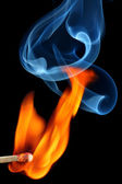Matchstick bursting to flame with smoke — Stock Photo