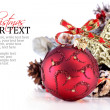 Christmas ornament with red ribbon, pine cones and star - Stock Photo