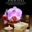 Spa aromatherapy setting, orchids and handmade soap bars - Stock Photo