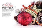 Christmas ornament with red ribbon, pine cones and star — Стоковое фото