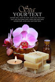 Spa aromatherapy setting, orchids and handmade soap bars — Stock Photo